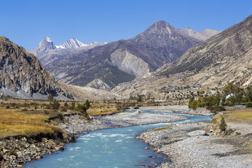 Majestic landscape and blue river in Himalayas mountains in Nepal