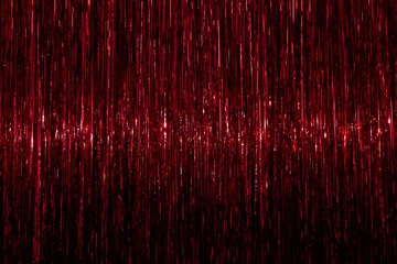 Tinsel background. Red sparkling abstract texture