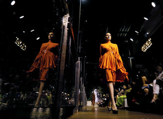 A model presents during the first day of HSBC Colombo Fashion week in Colombo