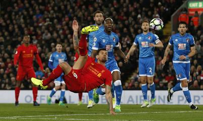 Liverpool's Dejan Lovren shoots at goal