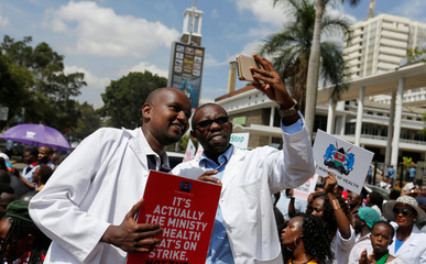 Striking doctors take a selfie photograph outside the Court of Appeal as they wait for the release of jailed officials of the national doctors' union in Kenya's capital Nairobi