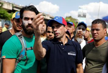 Opposition leader Henrique Capriles gestures during a rally in Caracas, Venezuela