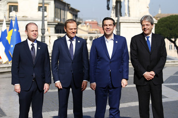 """Malta's PM Muscat, European Council President Tusk, Greek PM Tsipras and Italy's PM Gentiloni pose for a picture outside the city hall """"Campidoglio"""" on the 60th anniversary of the Treaty of Rome, in Rome"""