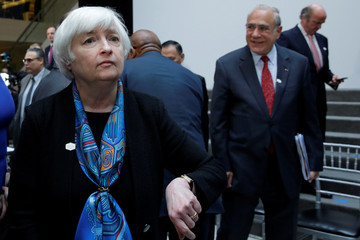 Federal Reserve Chair Janet Yellen leaves after G-20 family photo during the IMF/World Bank spring meetings in Washington