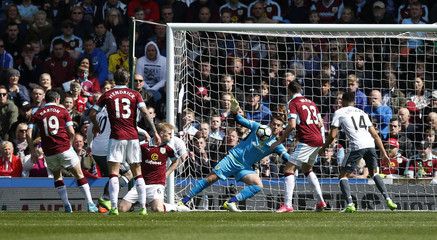 Burnley's Tom Heaton saves from Manchester United's Wayne Rooney