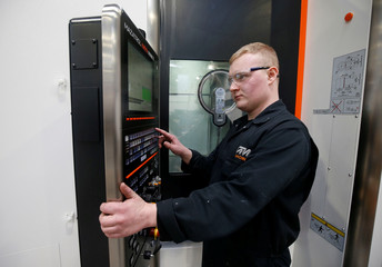 Apprentice Joshua Harvey works with a CNC cutting machine at GW cast in Bridgnorth