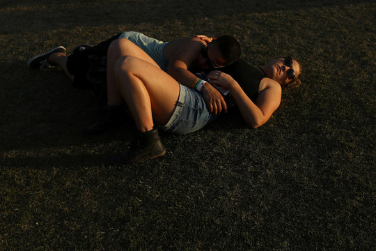 A couple sleep on the grounds during the Coachella Valley Music and Arts Festival