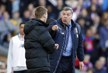 Crystal Palace manager Sam Allardyce speaks to the fourth official