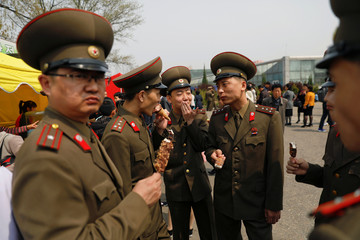 Soldiers enjoy ice-cream in central Pyongyang