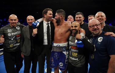 Tony Bellew celebrates winning his fight with Eddie Hearn