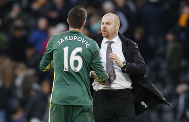 Burnley manager Sean Dyche and Hull City's Eldin Jakupovic shake hands after the game