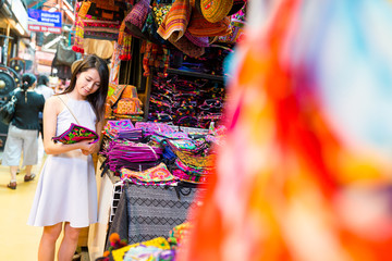Asian Woman shopping in street market at thailand