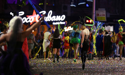A participant in the annual Sydney Gay and Lesbian Mardi Gras parade wears horns as he looks back on the parade route in Sydney