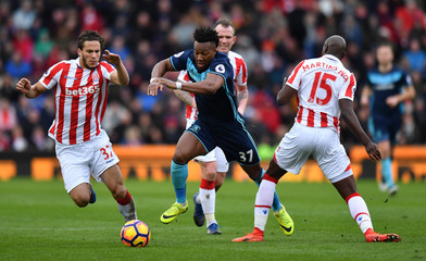 Middlesbrough's Adama Traore in action with Stoke City's Bruno Martins Indi and Ramadan Sobhi