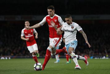 Arsenal's Granit Xhaka in action with West Ham United's Manuel Lanzini