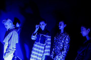 Models wait backstage for the start of the JD & Uyen fashion show by Han Dongyang at China Fashion Week in Beijing