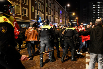 Demonstrators clash with riot police during running battles in the streets near the Turkish consulate in Rotterdam