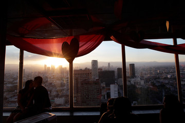 A couple is seen kissing at the cafeteria of the Torre Latinoamericana on Valentine's Day in Mexico City
