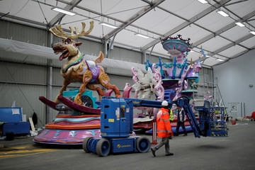 Employees work on the Frozen's Char for the Disney Stars on Parade, the new parade to celebrate the 25th anniversary of the park, at the Chars Workshop in Disneyland Paris in Marne-la-Vallee