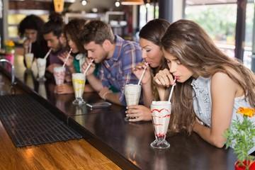 Friends drinking smoothie at restaurant