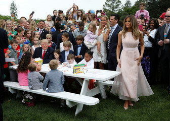 U.S. President Donald Trump and U.S. first lady Melania Trump are pictured at the 139th annual White House Easter Egg Roll on the South Lawn of the White House in Washington