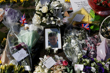 Floral tributes lie in Parliament Square following the attack in Westminster, central London