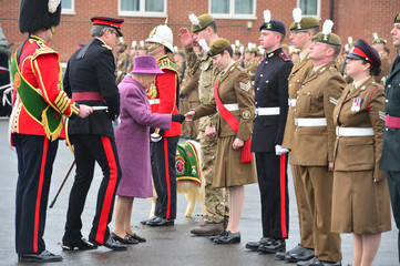 Britain's Queen Elizabeth reviews members of The Royal Welsh Regimental Family at Lucknow Barracks during a visit to mark St David's Day, in Tidworth