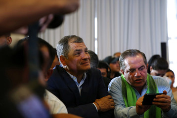 Ecuadorean President Correa gestures while waiting near presidential candidate Lenin Moreno (not pictured) for the results of the national election in a hotel, in Quito
