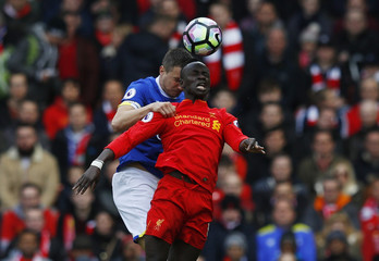 Liverpool's Sadio Mane in action with Everton's Phil Jagielka