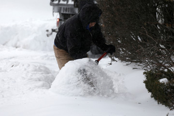 A man shovels snow during a snowstorm in the village of Nyack