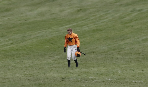 Lizzie Kelly looks dejected after falling from Tea for Two during the 3.30 Timico Cheltenham Gold Cup Chase