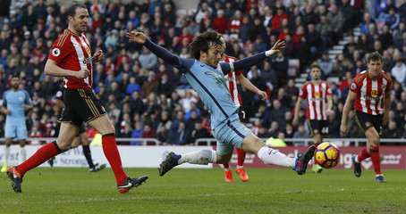 Manchester City's David Silva misses a chance to score