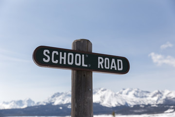 School Road Sign in Mountain Town