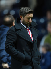 Bristol City manager Lee Johnson is dejected after the match
