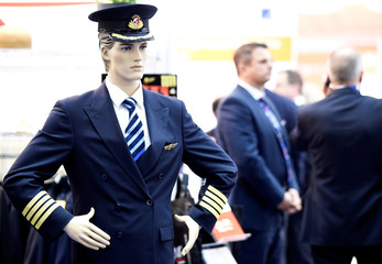 A mannequin in a flight crew uniform is displayed at the booth of PDM Corporate Fashion at the Aircraft Interiors Expo 2017 in Hamburg