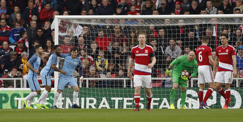 Manchester City's David Silva celebrates scoring their first goal