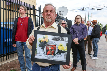 Chuck Berry fan Steve Mudd holds artwork as he waits in line to pay his respects to the late rock 'n' roll visionary at The Pageant club in St. Louis