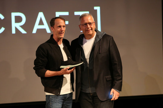 Adidas Executive Board Global Brands manager Eric Liedtke holds the new Futurecraft shoe with Carbon 3D printing company CEO Joe DeSimone at an unveiling event in New York City
