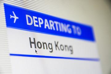 Computer screen close-up of status of flight departing to Hong Kong, China
