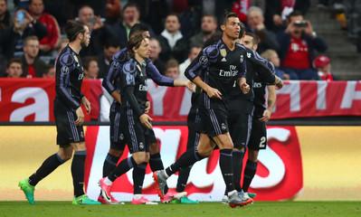Real Madrid's Cristiano Ronaldo celebrates scoring their first goal with team mates