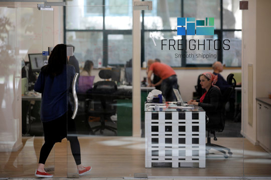A woman enters the offices of Freightos, an online marketplace for international shipping, in Jerusalem
