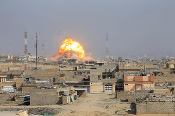 Smoke rises after an airstrike, during the battle against Islamic State militants, at the district of al-Mamoun in Mosul