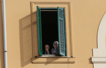 People look out from a window as Pope Francis arrives to attend a meeting at the University Roma Tre in Rome