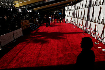 A woman watches over the red carpet outside the Dolby Theatre as preparations continue for the 89th Academy Awards in Hollywood, Los Angeles, California