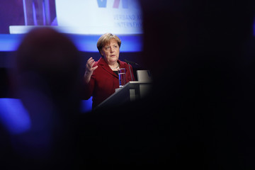 German Chancellor Merkel addresses a meeting of the German Association of Local Utilities in Berlin