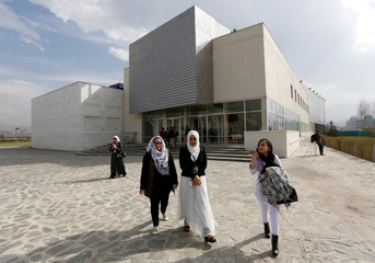 Female students of American University of Afghanistan walk as they arrive for new orientation sessions at a American University in Kabul, Afghanistan