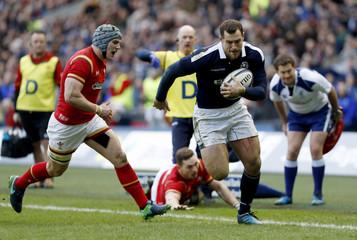 Scotland's Tim Visser runs in before scoring their second try