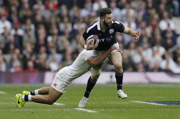 England's Jonathan Joseph in action with with Scotland's Alex Dunbar