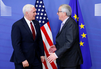 U.S. Vice President Mike Pence poses with European Commission President Jean-Claude Juncker at the EU Commission headquarters in Brussels, Belgium