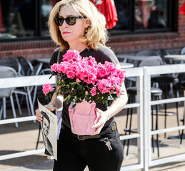 A fan carries flowers as she pays her respects to the late rock 'n' roll visionary Chuck Berry at his funeral at The Pageant club in St. Louis